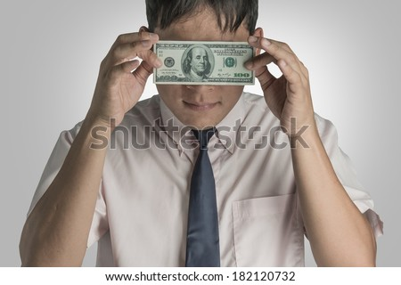 Businessman with dollar close eyes. - stock photo