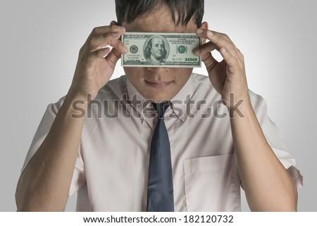 Businessman with dollar close eyes. - stock photo