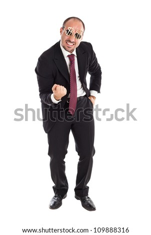 Businessman with dollar-sign glasses standing - stock photo
