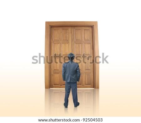Businessman with door - stock photo