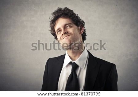 Businessman with doubtful expression - stock photo
