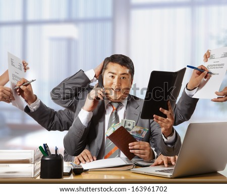 businessman with eight hands in elegant suit working hold notepad clipboard, cell phone, paper, document, contract, folder business plan. Concept of busy - stock photo