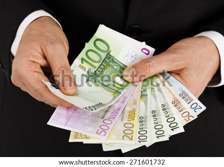 Businessman with euro bills in his hands close up - stock photo