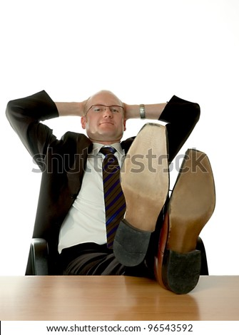 businessman with feet on desk - stock photo