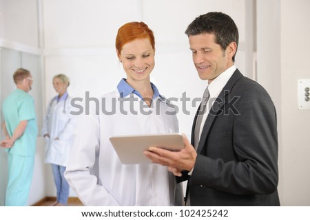 Businessman with Female Doctor at the Hospital - stock photo