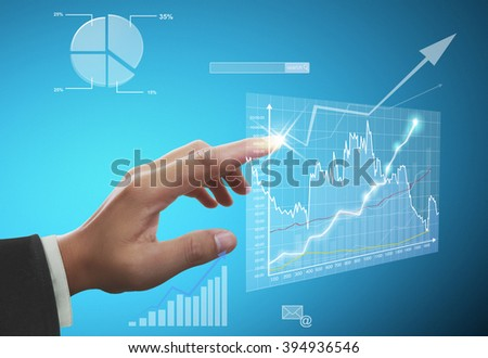 Businessman with financial symbols coming - stock photo