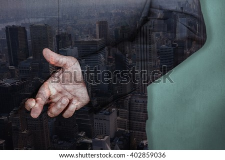 Businessman with fingers crossed against blue background - stock photo
