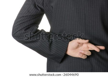 Businessman with fingers crossed behind his back. - stock photo