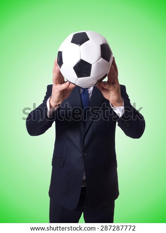 Businessman with football against the gradient - stock photo