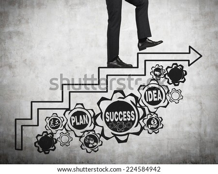 Businessman with gears - A concept of well organized work process.  - stock photo