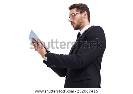 Businessman with glasses using his tablet on white background