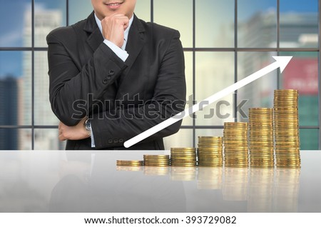 Businessman with gold coins growth up in office conference meeting room on photo blurred cityscape, Business investment growth concept - stock photo