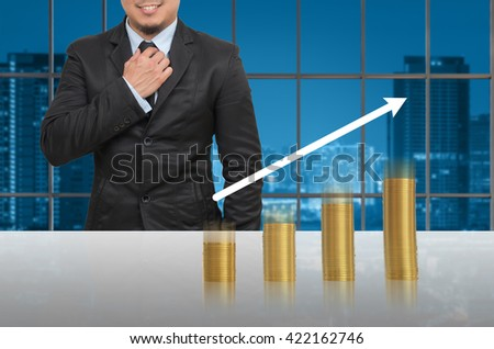 Businessman with gold coins growth up in office conference meeting room on photo blurred cityscape, Business investment growth concept