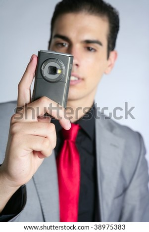 Businessman with gray suit taking photos with phone camera - stock photo