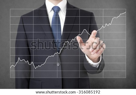 Businessman with growing chart - stock photo