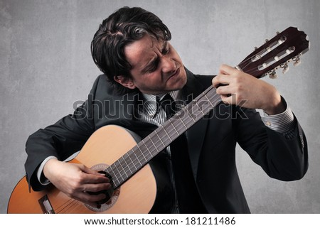 businessman with guitar - stock photo