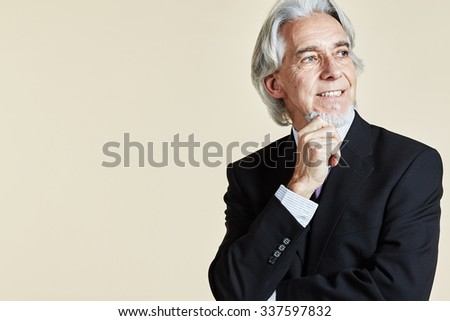 Businessman with hand at chin