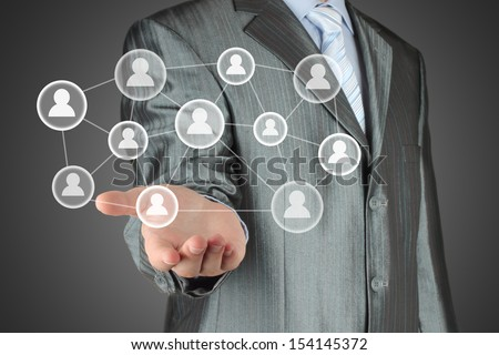 Businessman with hand holding virtual social media buttons - stock photo