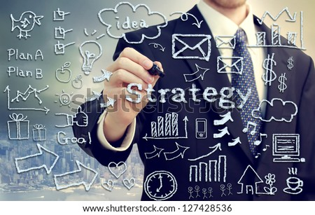 Businessman with hand written business themed texts and pictures - stock photo