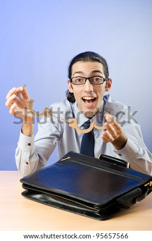 Businessman with handcuffs in concept