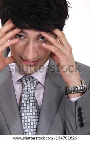 businessman with hands to forehead facing pressure - stock photo
