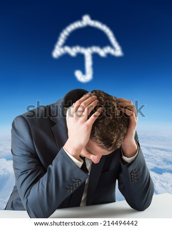 Businessman with head in hands against blue sky over clouds at high altitude