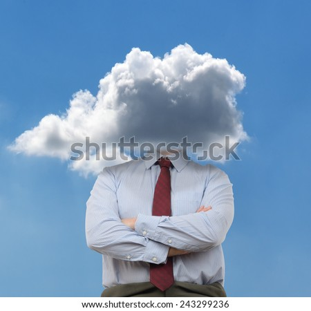 Businessman with head in the clouds - stock photo