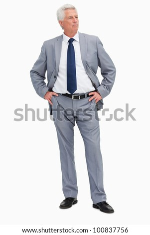 Businessman with her hands on her hips against white background