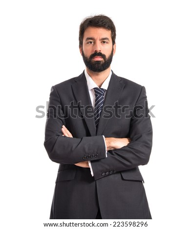 Businessman with his arms crossed over white background - stock photo
