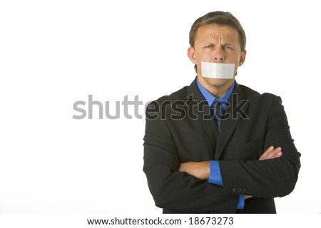 Businessman With His Arms Folded  And His Mouth Taped Shut - stock photo