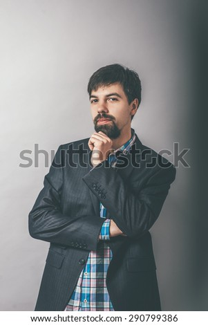 businessman with his chin fist - stock photo