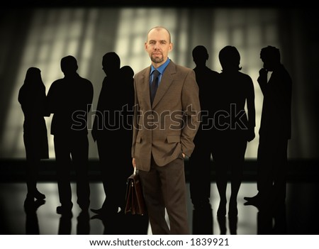 Businessman with his group(made from my images,special f/x) - stock photo