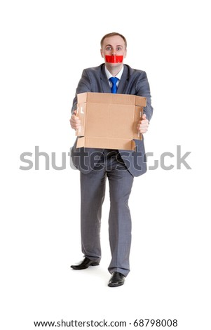 Businessman with his mouth sealed with red tape and cardboard in their hands - stock photo