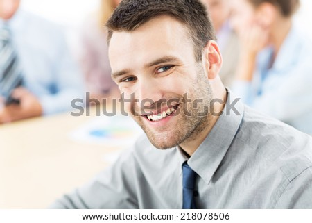 Businessman with his team  - stock photo