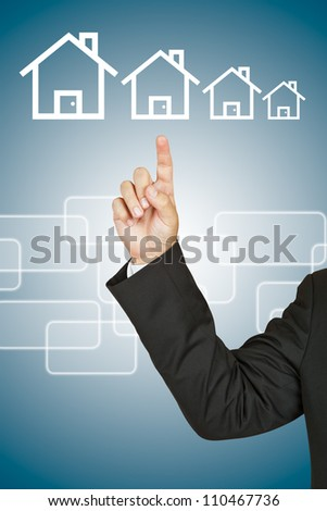 Businessman with house - stock photo