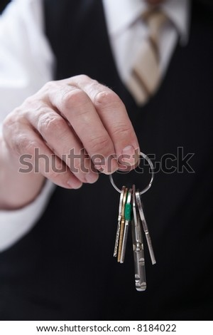 businessman with key of success - stock photo