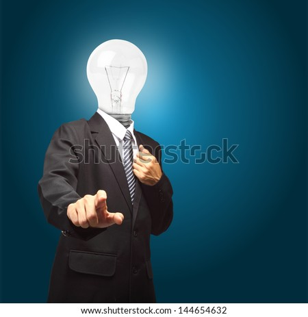 businessman with lamp head push the button on virtual touch pad, Objects with clipping paths for design work - stock photo