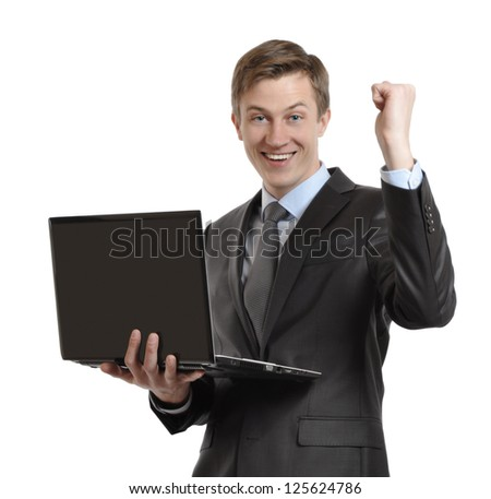 businessman with laptop celebrating victory with clenched fists and raised his hand. isolated on white