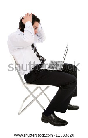 Businessman with laptop, holding head in hands - stock photo