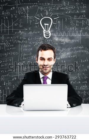 Businessman with laptop, idea concept - stock photo