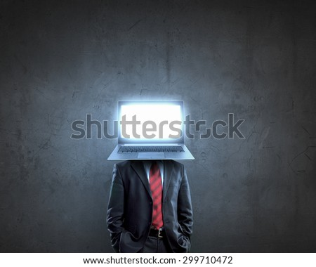 Businessman with laptop instead of his head - stock photo