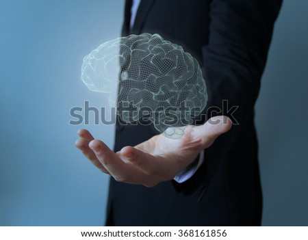 businessman with light brain over hand