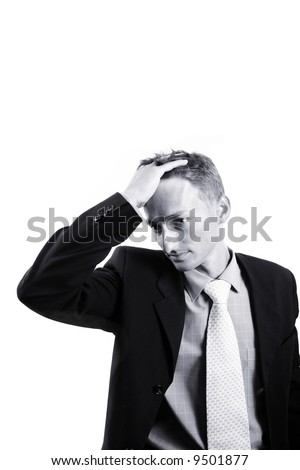 businessman with lots of things on his mind - stock photo