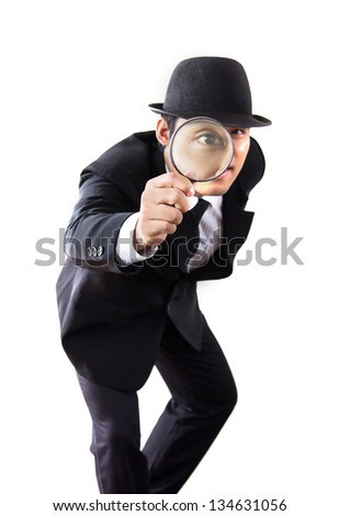 Businessman with magnifying glass in the Hands. - stock photo