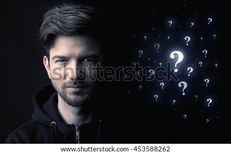 businessman with many question mark near him - stock photo