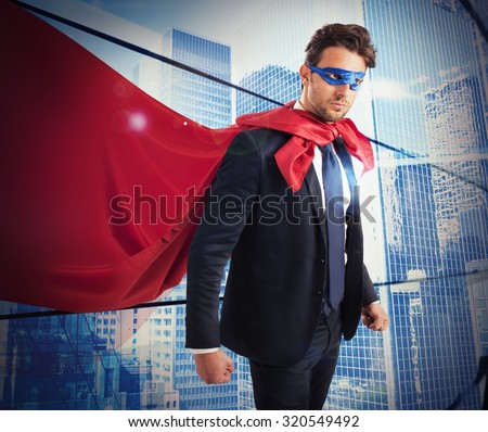 Businessman with mask and mantle of hero - stock photo