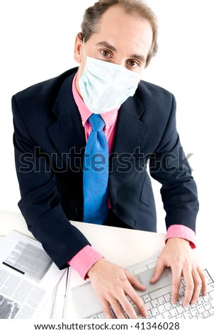 Businessman with medical mask for Flu prevention at work. - stock photo