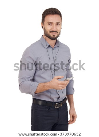 Businessman with mobile phone and headphones