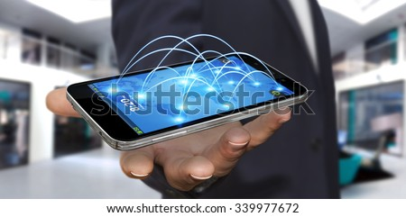 Businessman with modern mobile phone connecting different places of the world - stock photo