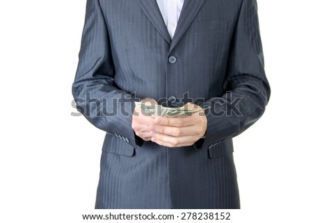 Businessman with money in hand. Isolated on White Background - stock photo
